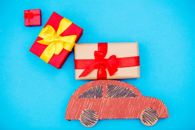 Red handmade car delivery with christmas gift boxes