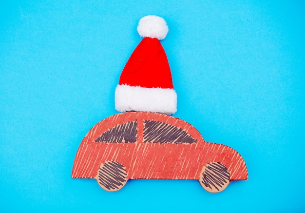 Red handmade car delivery with christmas hat