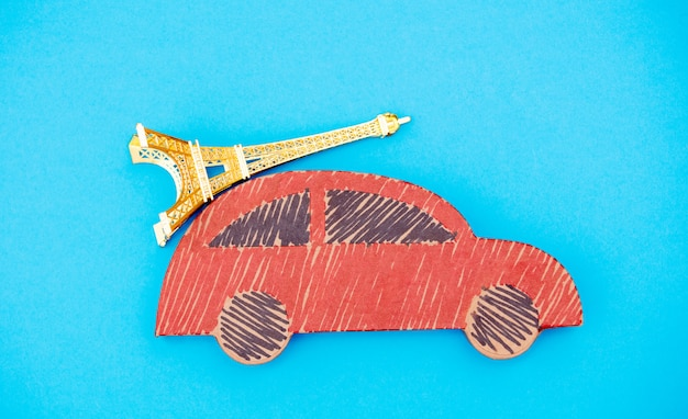 Red handmade car delivery with eiffel tower souvenir
