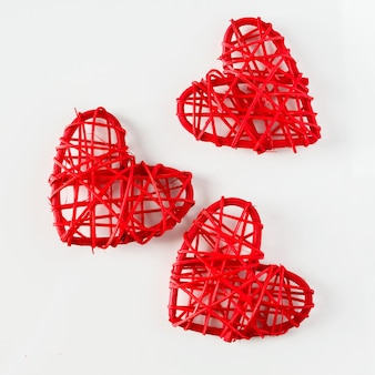 Red handmade hearts made of twigs on a white background
