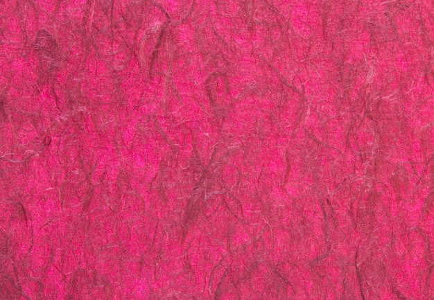 Red handmade paper or mulberry paper texture for background