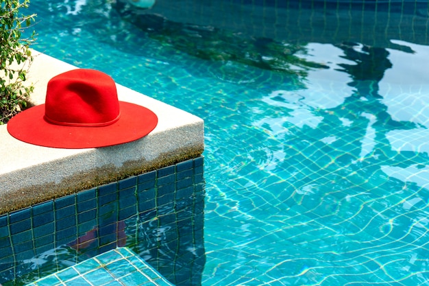 Red hat on the blue water swimming pool