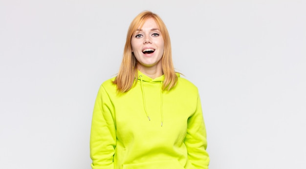 Red head pretty woman with a big, friendly, carefree smile, looking positive, relaxed and happy, chilling