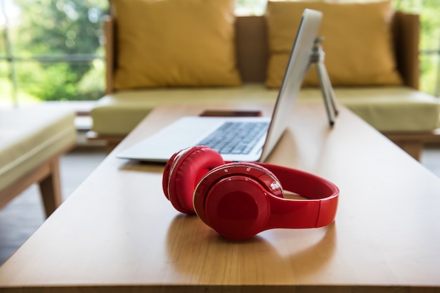 Red headphones and laptop. leisure lifestyle