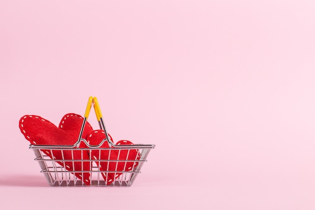 Red heart as a symbol of love, in a shopping basket