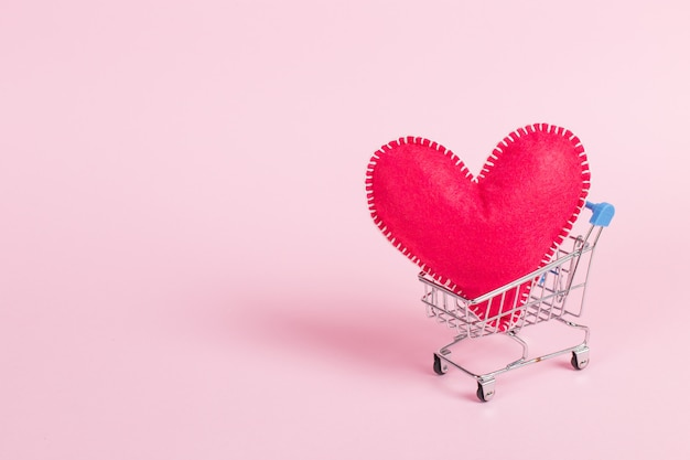 Red heart as a symbol of love, in a shopping trolley