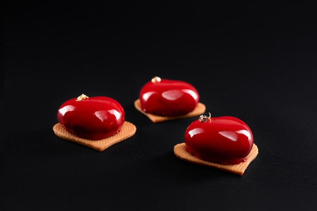 Red heart cakes decorated with gold isolated