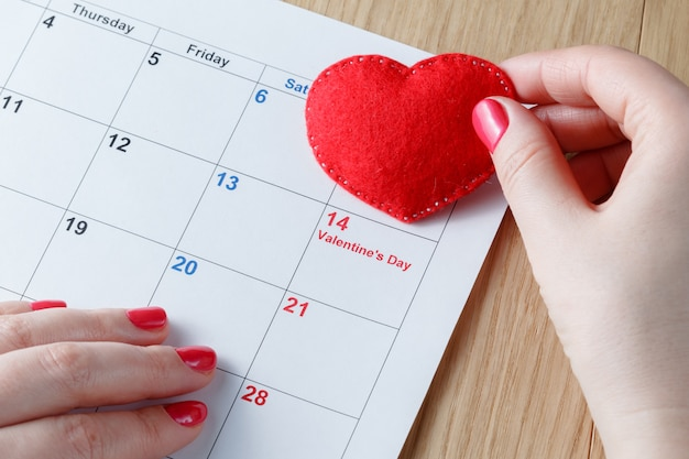 Red heart and calendar, love month