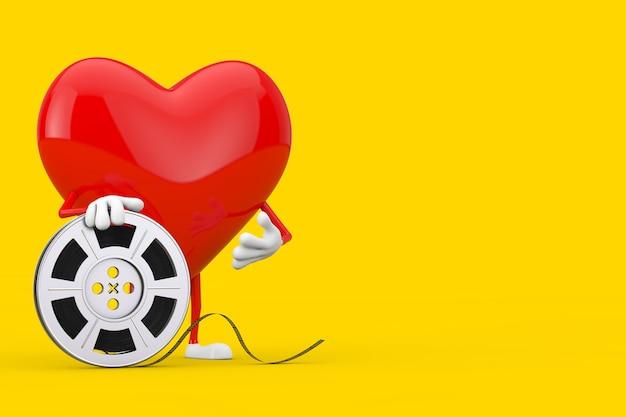 Красный талисман характера сердца с лентой кино вьюрка фильма на желтой предпосылке. 3d рендеринг