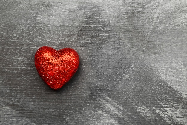 Red heart on a dark background. top view, copy space