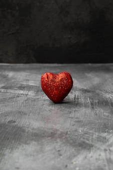 Red heart on a dark background