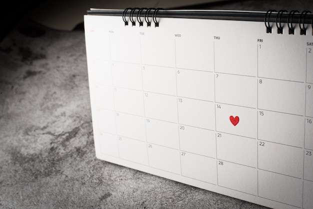 Red heart in february 14 on the calendar, valentine's day concept
