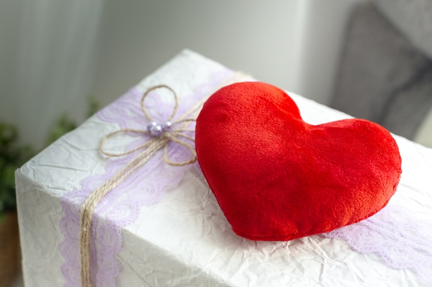 Red heart over gift box or present
