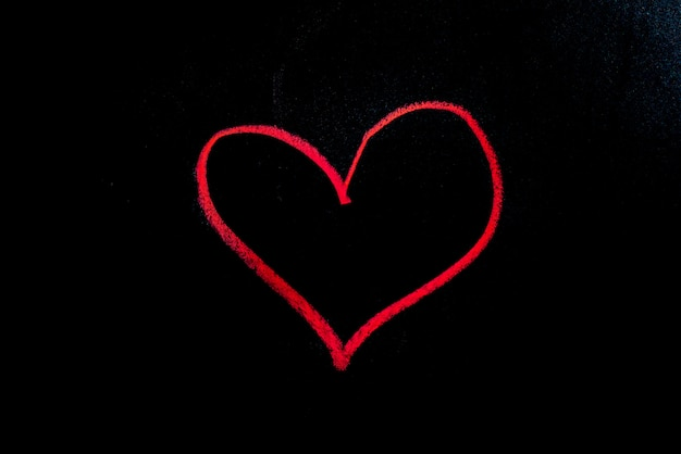 Red heart, hand drawn on a black chalkboard for valentine.