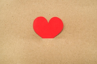 Red heart in middle of cardboard
