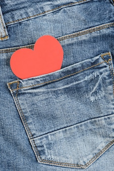 Red heart in jeans pocket. valentines day concept.