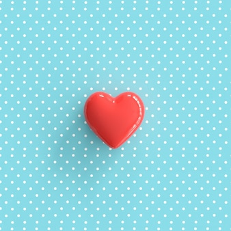 Red heart on pokadot blue background. minimal valentine concept idea.