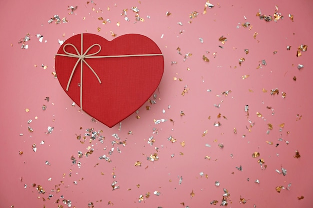 Red heart shape gift box on festive pink