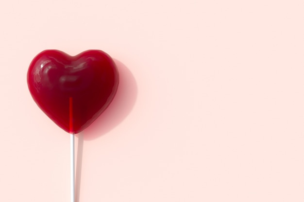 Red heart shape of lollipop candy on pink background for copy space. 3d render. minimal valentine concept idea.