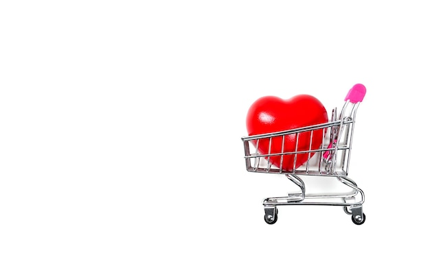 Red heart in shopping cart or trolley isolated on white backgroundblood pressure controlhealth car