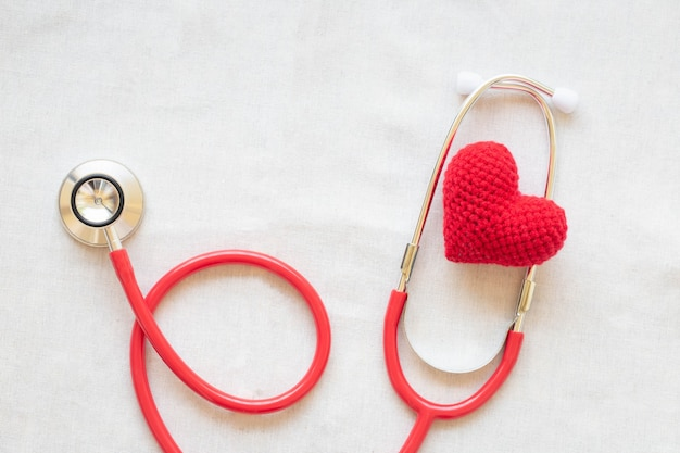 Red heart and stethoscope. concept for heart health, cardiology, world heart day, hypertension.