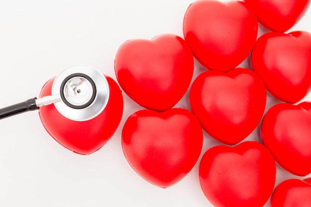 Red heart and a stethoscope. isolated on white background.