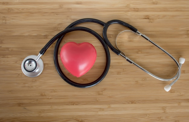 Red heart and a stethoscope on wooden table, world health day campaign