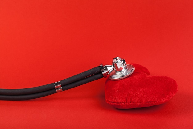Red heart and a stethoscope