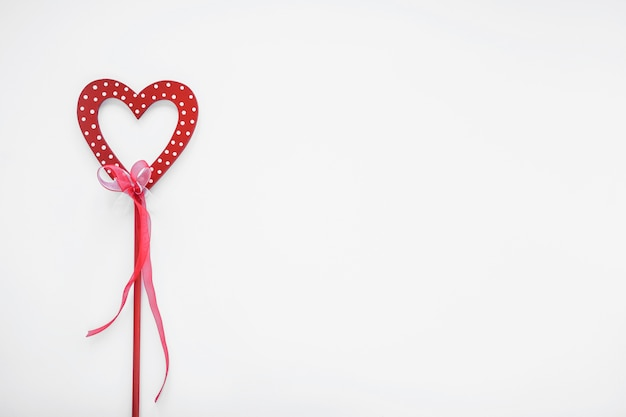 Red heart on stick with ribbon