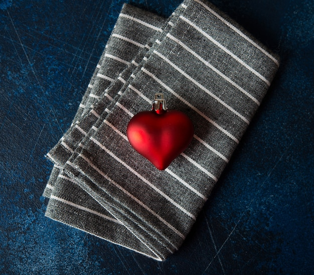 Red heart-a symbol of love, valentine's day. heart on a napkin, top view