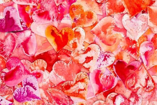 赤いハートのバレンタインデーの抽象的な背景。