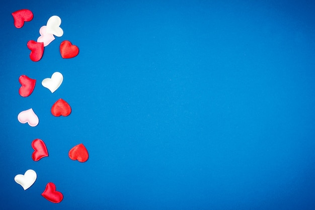 Red heart for valentine's day on a beautiful blue background. heart pendant.