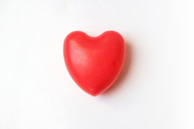 Red heart on white background. love, care, and valentine day concept. world heart health day idea.
