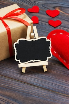 A red heart with black board and small hearts. copy space