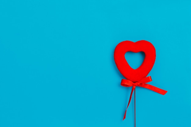 Red heart with a bow on a blue surface, love, valentine's day
