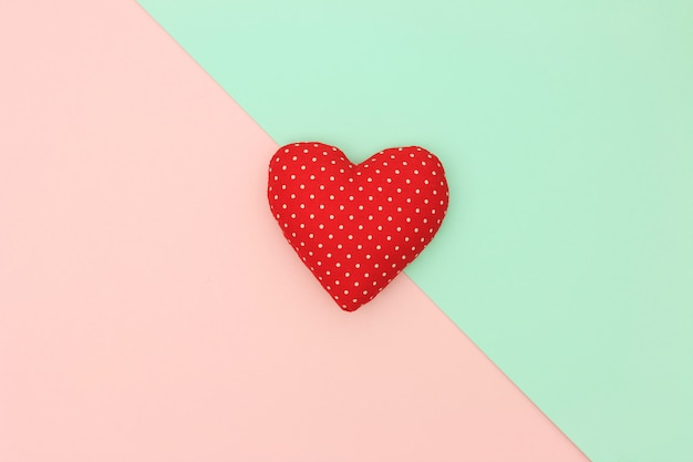 Red heart with copy space on pastel background. love and valentine day concept. minimal style.