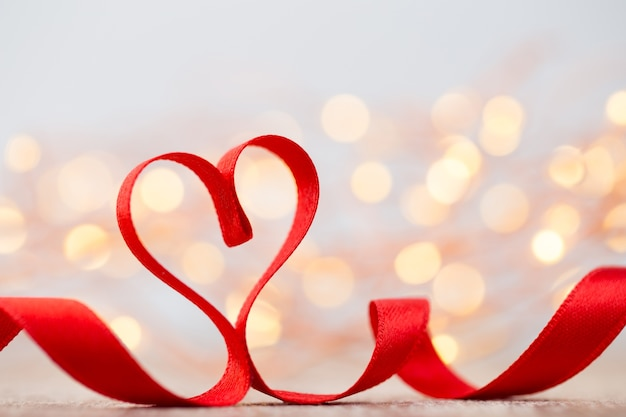 Red heart with ribbon. valentines day space.