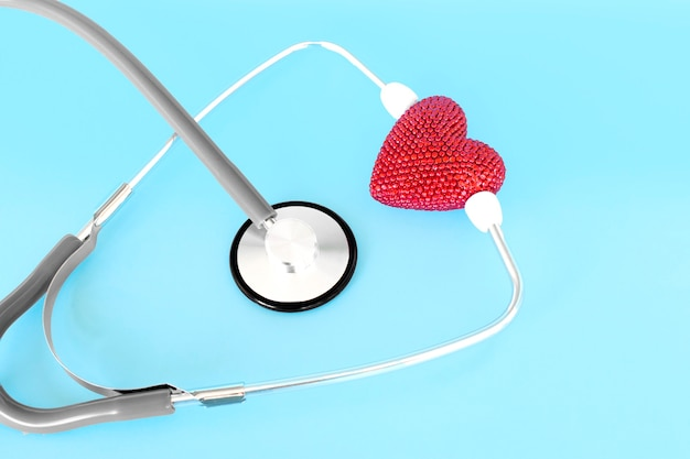 Red heart with stethoscope, heart health, health insurance concept, world heart day, world health day, world hypertension day Premium Photo