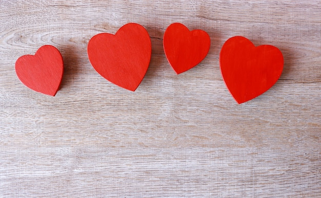 Red heart on wood background.