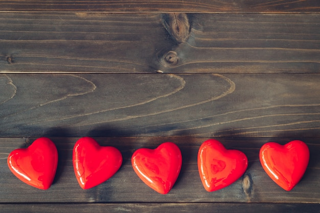 Red heart on wood table background with copy space