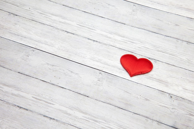Red heart on wooden background, love concept, space for text.