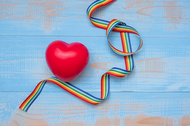 Red heartr shape with lgbtq rainbow ribbon