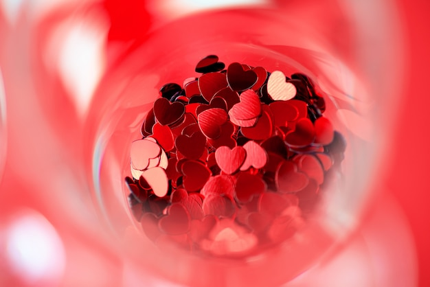Red hearts are scattered in a glass. valentine's day concept.