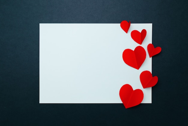 Red hearts on blank paper