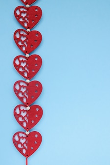 Red hearts on blue background. valentines day background with hearts. copyplace, space for text and logo.