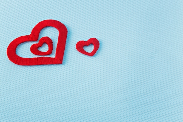 Red hearts on a blue background