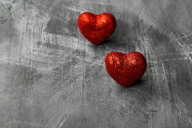 Red hearts on a dark background. copy space. food background