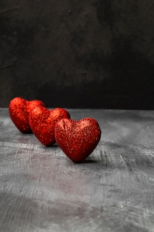 Red hearts on a dark background