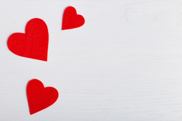 Red hearts of different sizes on a white background
