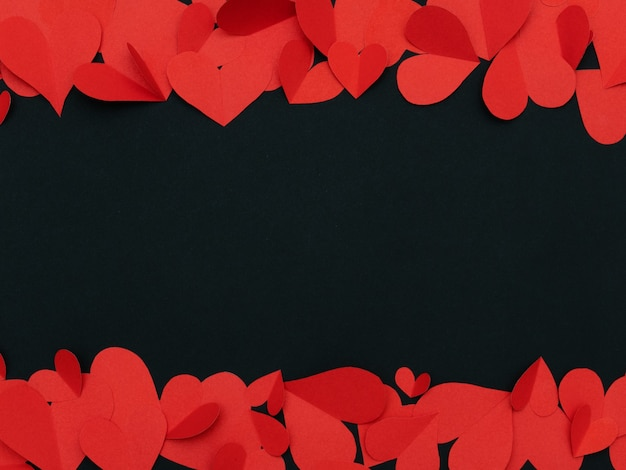 Red hearts frame on black with copy space for valentine love wedding concept background